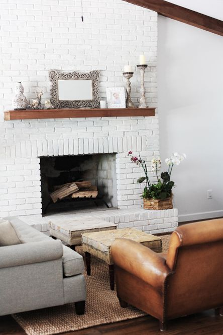 white fireplace  wood & white so clean looking Make a dark stained wood mantle to go over brick mantel? Look like a floating shelf?