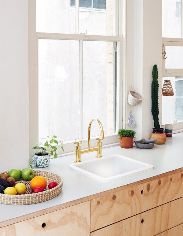 Clare Cousins, Plywood House, Flinders Lane, Melbourne | Remodelista.  Countertop flush with cabinets. Also countertop could be IKEA pre made.
