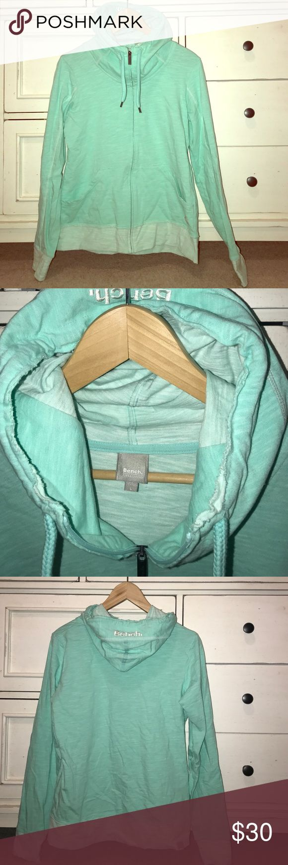 """NWOT womens large bench hoodie in teal Gorgeous (despite the wrinkles) large bench hoodie in teal. Has an awesome zip up that keeps your neck warm. Bought it and took the tags off and decided the color just wasn't for me! Shoulder 17-18"""" bust 21"""" length 25"""" stretchy material. Bench Tops Sweatshirts & Hoodies"""