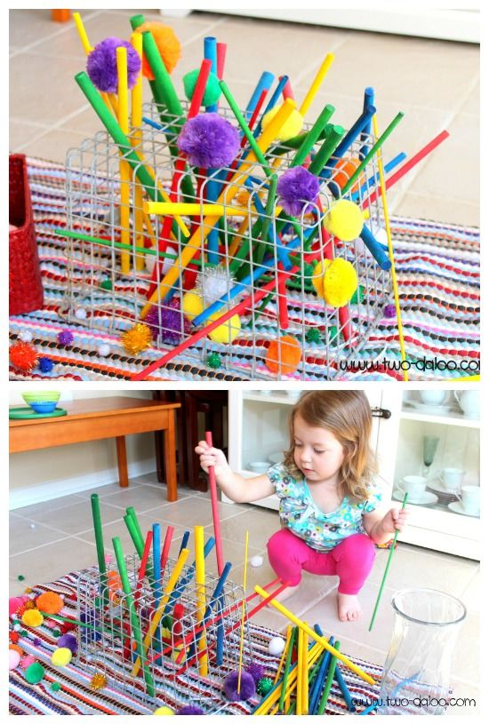 Toddler Wire Basket Sculpture- a simple invitation to create with an old wire locker basket, colored dowel rods, and pom poms. Great for fine motor with beautiful results!