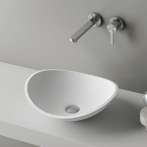 Countertop washbasin / oval / Corian® / contemporary ATTICA by Marco Devigili PLANIT
