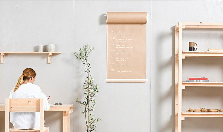 New Zealand-based furniture designers George Wilkins and William McCallum inadvertently created the Studio Roller when they dug up a discarded roll of butcher's paper and mounted it to the wall, using it as a continuous scratchpad for brainstorming ideas and making lists.