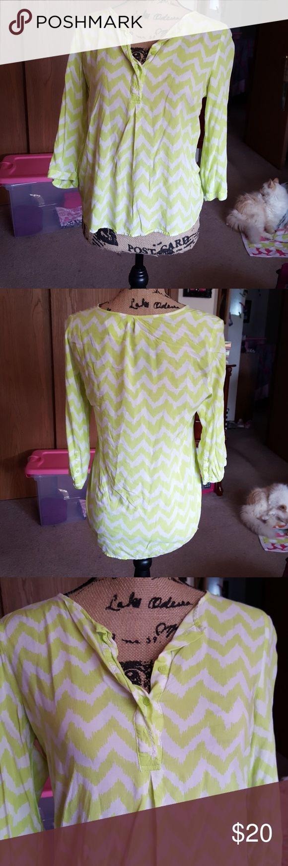 Neon yellow chevron shirt. Like New. Small Neon yellow chevron shirt. Like New. Small. 100% rayon. High low type top. none Tops Blouses