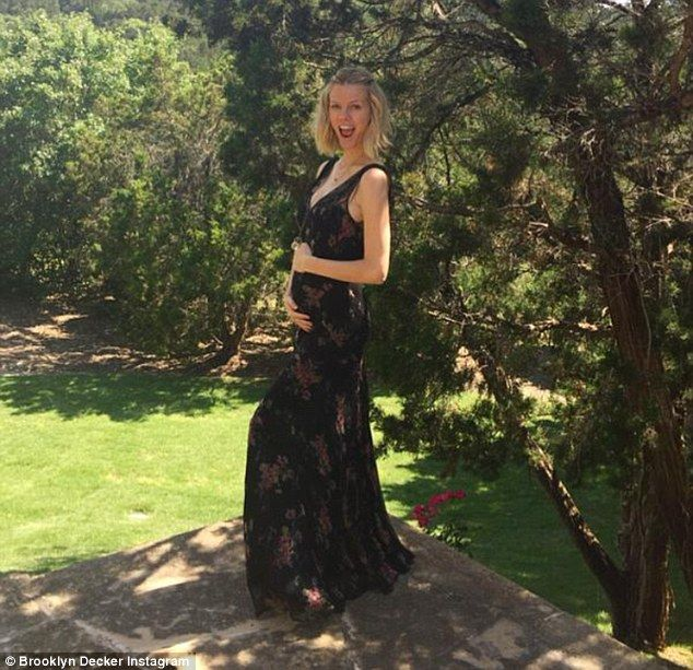 'So this happened!' Brooklyn Decker reveals she is expecting her first child with tennis player husband Andy Roddick by posting this picture holding her bump on Saturday