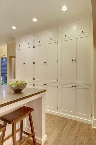 Floor to ceiling cabinets - for the playroom.  I like that it would be functional even when the space is no longer a playroom