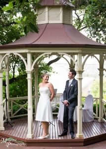 Bride and groom in the gazebo  - at Ascot House