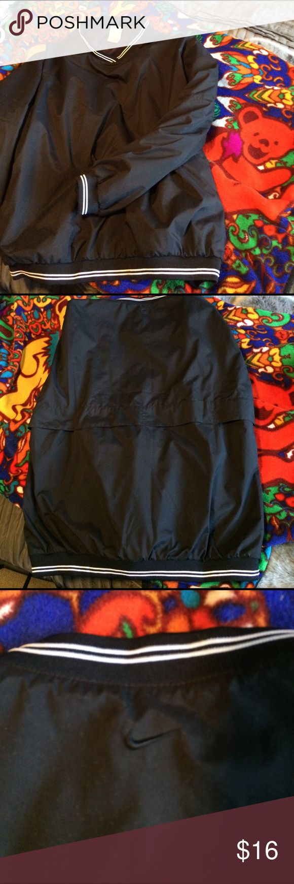 Nike ClimaFit Ladies p/o in Med with zip pockets Nike Clima Fit black Ladies p/o in Medium with 2 zip front pockets and black Nike swish on back collar. Black with black and white trim. Excellent condition besides initial on label. See pic. Nike Tops Sweatshirts & Hoodies