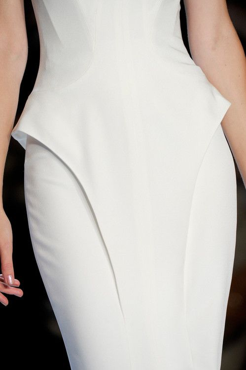 Sculptural silhouette - structured dress with dimensional detail; line and curve // Monique Lhuillier