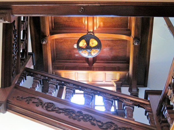 View up the hand-carved stairs in historic Bettendorf Mansion, campus of…