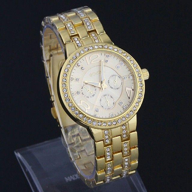 Geneva Diamond Fashion Watch (Jam Tangan Fesyen Berlian - Intan)  Harga Rp 140.000  Spesifikasi: - Brand: Geneva. - Grade: Original. - Tahan air: 1 ATM. - Diameter case: 3,5 cm. - Tebal case: 3,8 cm. - Bahan case: Alloy. - Panjang tali: 18 cm. - Lebar tali: 2,0 cm. - Bahan tali: Stainless steel. - Tipe clasp: Fold over clasp with push button. - Display: Analog. - Mesin: Quartz. - Chronomenter: Tidak aktif.