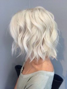 Icy platinum blonde hair in a long bob