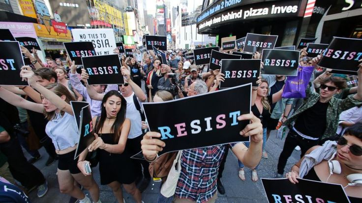 Demonstrators flocked to a military recruiting station in New York City and gathered at a plaza named for a San Francisco gay-rights icon on Wednesday to protest President Donald Trump's abrupt ban on transgender troops in the military.  A crowd of at least a few hundred people gathered... - #Ban, #Gather, #Protesters, #TopStories, #Transgender, #Troo, #Trump