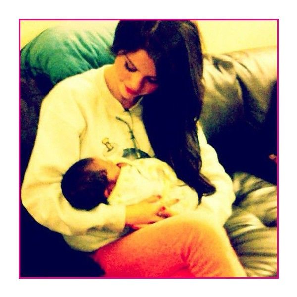 Picture Of Selena Gomez Holding A Baby ❤ liked on Polyvore featuring selena gomez, baby and selena
