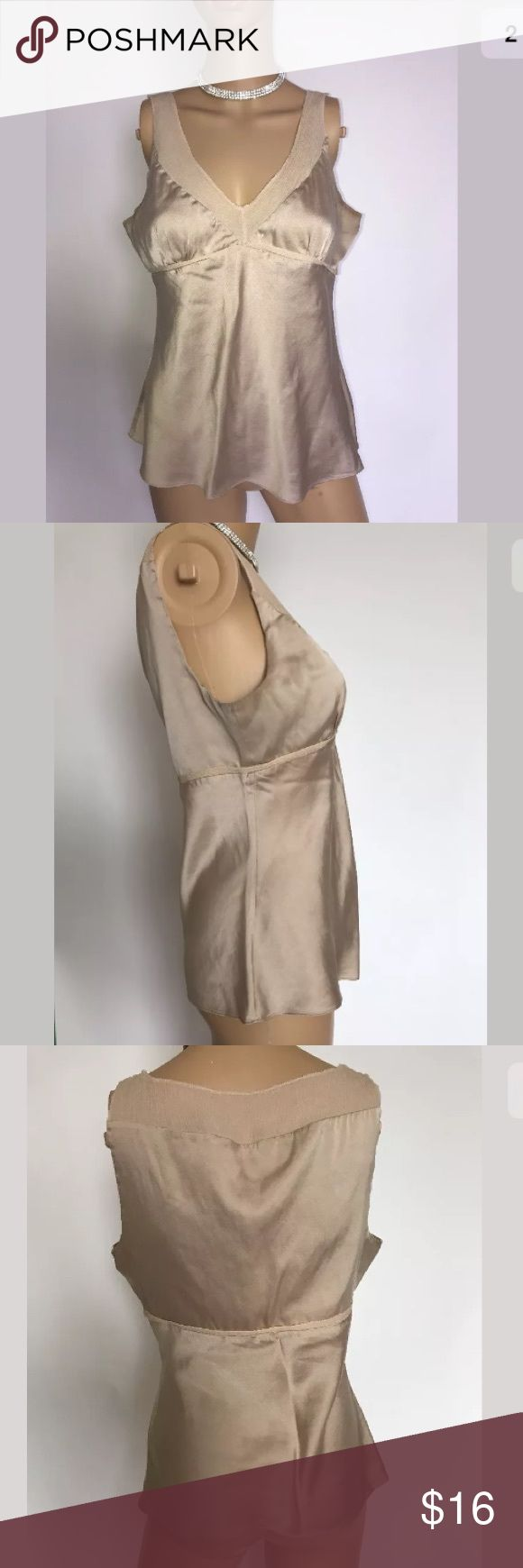 """Express Design Studio nude cami top M Express Design Studio nude cami top with concealed side zipper in size M.  Measurements laying flat are:  Bust: 15""""  Waist: 17""""  Length: 21""""  Material: 93% Silk 7% Spandex  Trim: 100% Silk  Made in China  Dry clean only express design studio Tops Camisoles"""