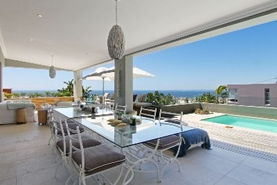 Modern contemporary with clean lines and great spaces. Super open plan living all flowing to lawned garden, undercover patio and pool. Lounge, dining room, kitchen and family room all on one level. Sublime sea and mountain views. 4 Bedrooms, 2 en suites. Multiple direct access garaging and staff quarters