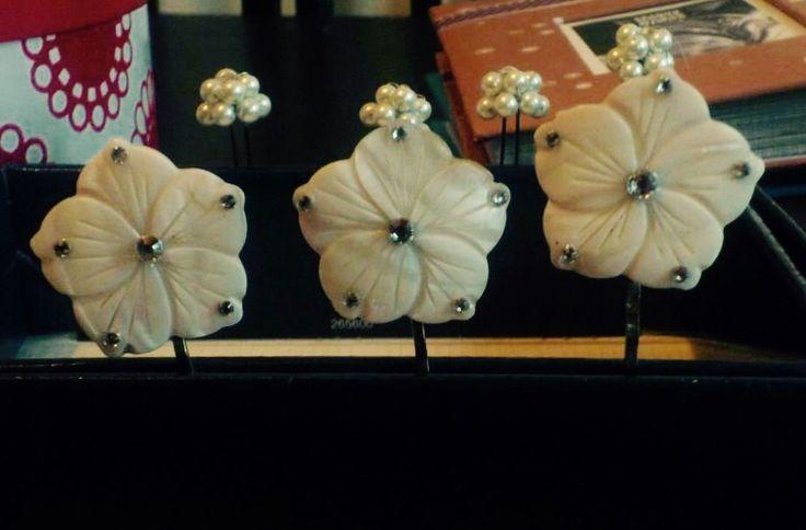 Bone flower, hair pins.