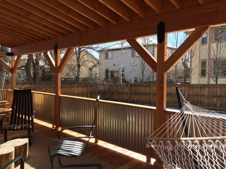 Covered Deck With Corrugated Metal Roof And Rails Metal