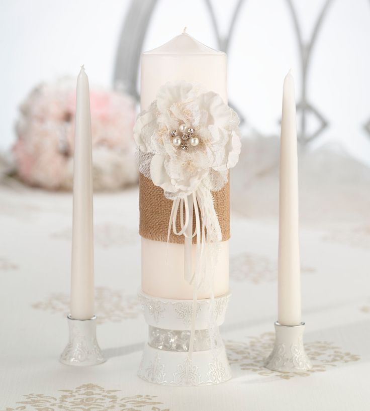 Pull the burlap and lace theme into the unity ceremony with this warm and natural candle set. Burlap is wrapped around the pillar candle and accented with a rhinestone filled, hand crafted paper flowe