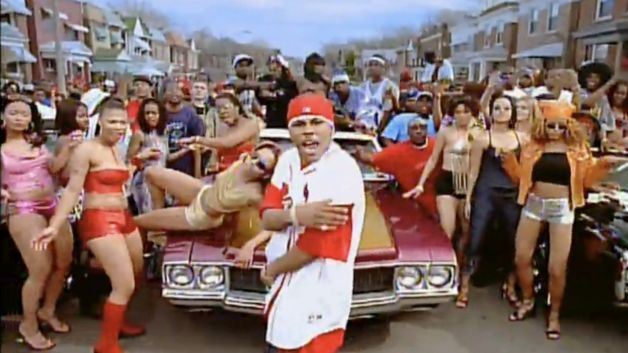 This Nelly video features scantily clad women by the dozen surrounding him in his front-and-center powerful looking position. (observation)