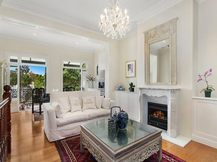 Very Elegant Living Room With White Fireplace Ornate