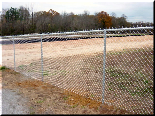 Chain link fences mark boundaries on sport fields. Contact us today for a free quote www.fenceworksofga.com