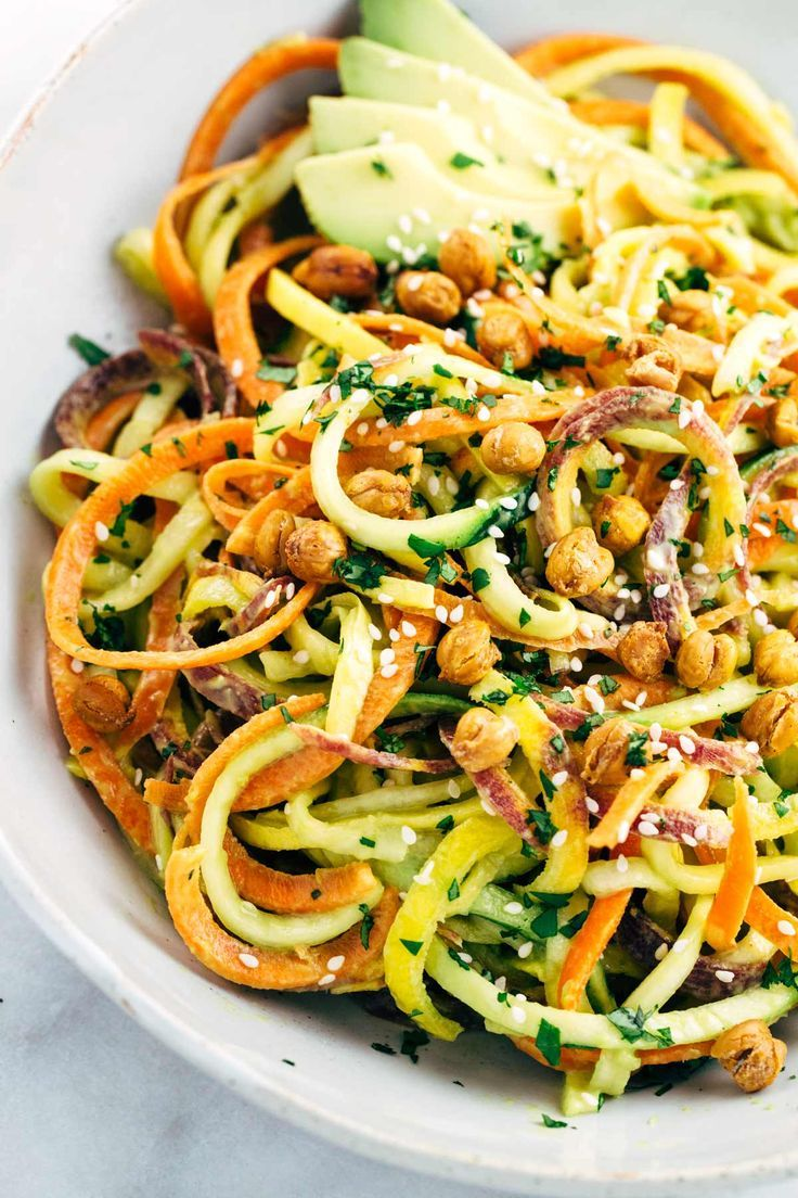 Spiralized Vegetable Salad with Roasted Chickpeas - Make yourself a healthy rainbow of colors for your next vegetarian meal and topped with a creamy avocado lemon sauce. | http://jessicagavin.com