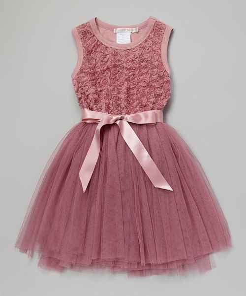 Gorgeous!  This Aussie-designed dress is the perfect pick for fancy occasions, pairing wearable comfort with fanciful style. The stretchy cotton-blend bodice is ruffled with rosettes, and the twirlable skirt is formed by lovely layers of soft tulle. Cotton / spandexMachine washImported