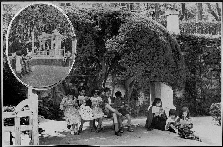 Título:    Niños leyendo en la biblioteca del parterre del Retiro  Fecha:    1936  Descripción:    Fotografía extraída del Album de recortes de la Biblioteca Musica