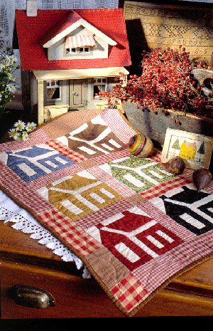 little house quilt- never saw this pattern done up in these patterns and colors and I like it