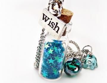 Darling wishing star necklace! 1 inch tall blown-glass, corked vials with an entire constellation of stars to carry with you everywhere. SO CUTE!!Available in :*Cotton andy (pink),**Blueberry Slush (b..