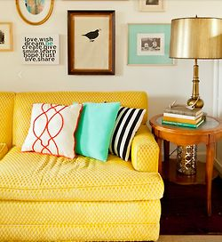 sunny yellow couch, aqua accents & gold table lamp