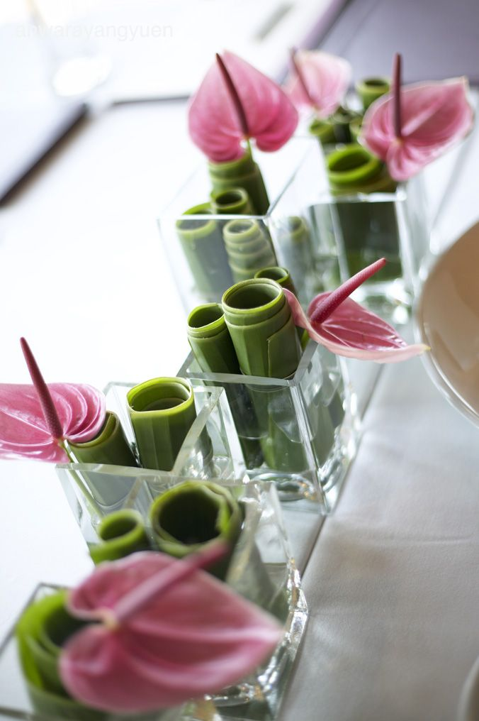 Anthurium + Bamboo centerpiece , have fun creating your own zen like floral presentations!