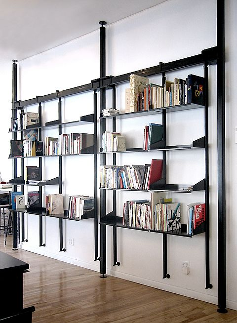 Custom pendant shelving system in blackened steel by Face Design +  Fabrication