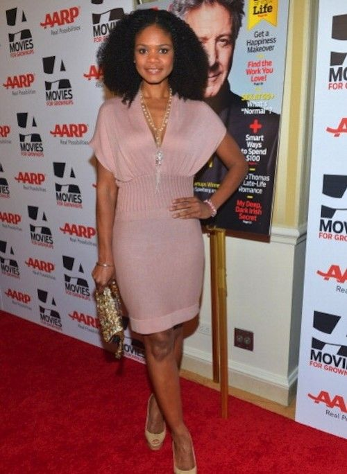 Colors for fashion Kimberly Elise wears pastel colored pink.