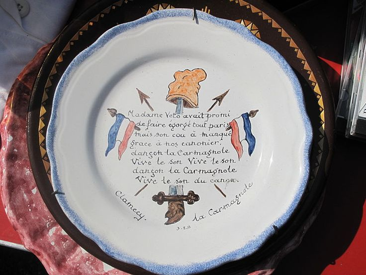 Plate with the beginning of the text of the song La Carmagnole : Madame Veto... (Wikipedia).