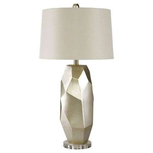 Inspired by modern art sculptures, this table lamp casts a light on originality. Free form shape naturally goes with the flow. Subtle metallic finish has a lovely hint of sheen.  Signature Design by Ashley is a registered trademark of Ashley Furniture Industries, Inc.
