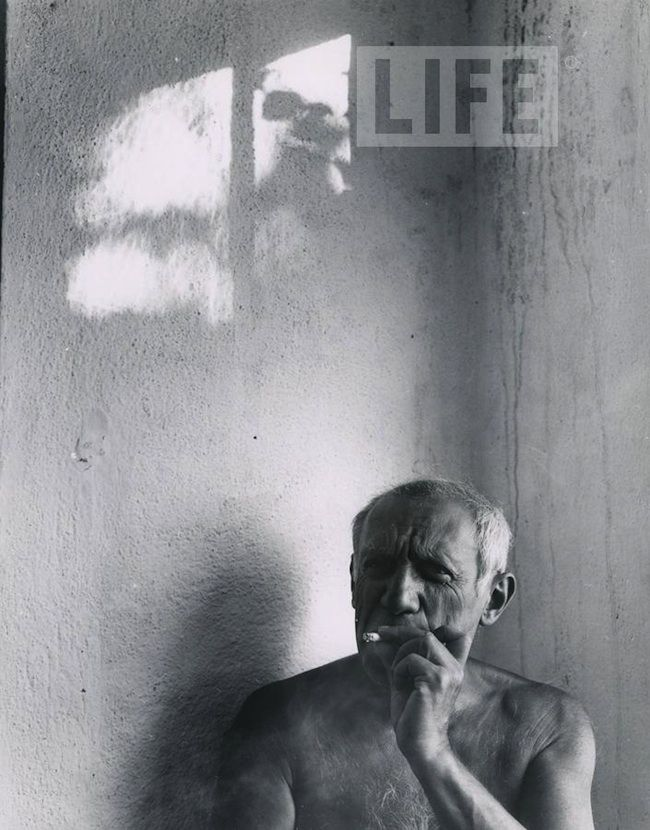 Pablo Picasso smoking a cigarette in Vallauris, France. 1949.