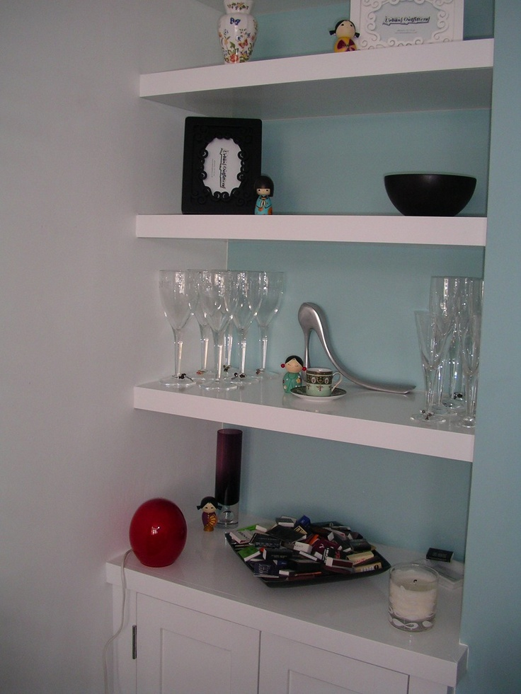 I want white floating shelves in the alcove with blue paint behind