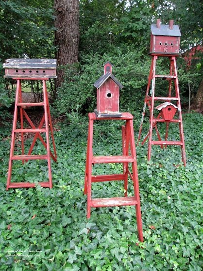 repurposed ladders into birdhouse stands