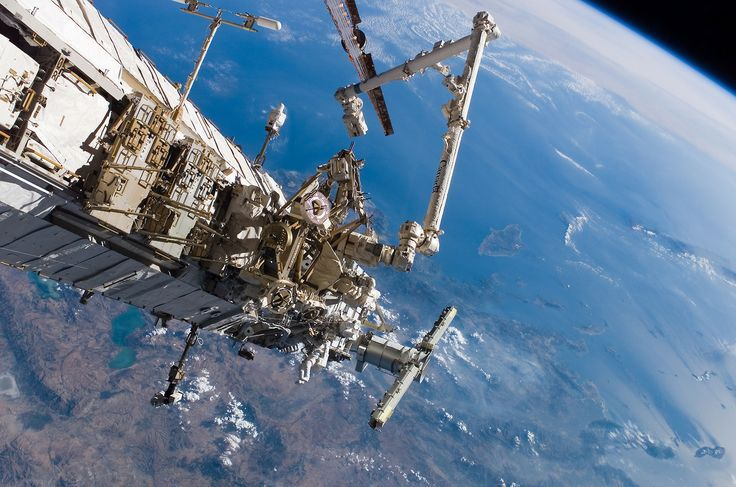 During space shuttle mission STS-115 in 2006, astronauts Steven G. MacLean and Daniel C. Burbank go on a spacewalk to work on the International Space Station (ISS). (Johnson Space Center Archive)