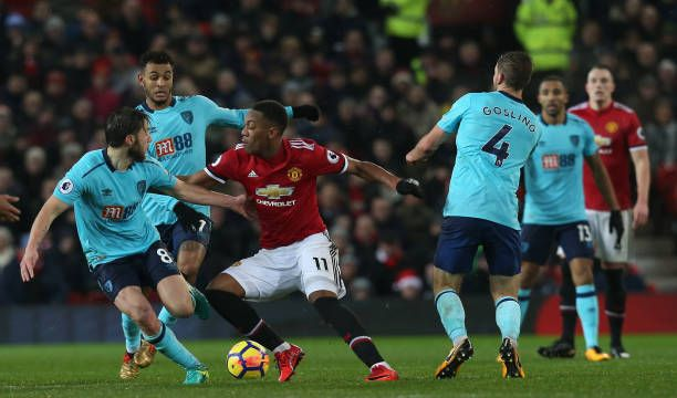 Anthony Martial of Manchester United in action with Harry Arter and Dan Gosling of AFC Bournemouth during the Premier League match between Manchester...