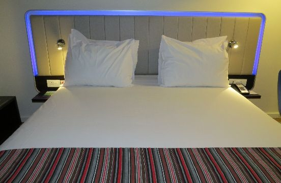 Bed at the Park Inn by Radisson with optional changing lights on the edge of the headboard