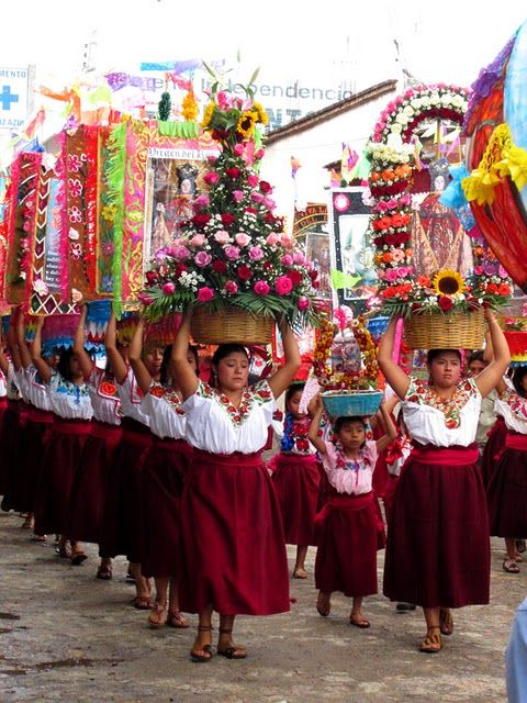 In Teotitlan del Valle, México, the parade or confite-all the unmarried women carry these fabulous arrangements thru the streets