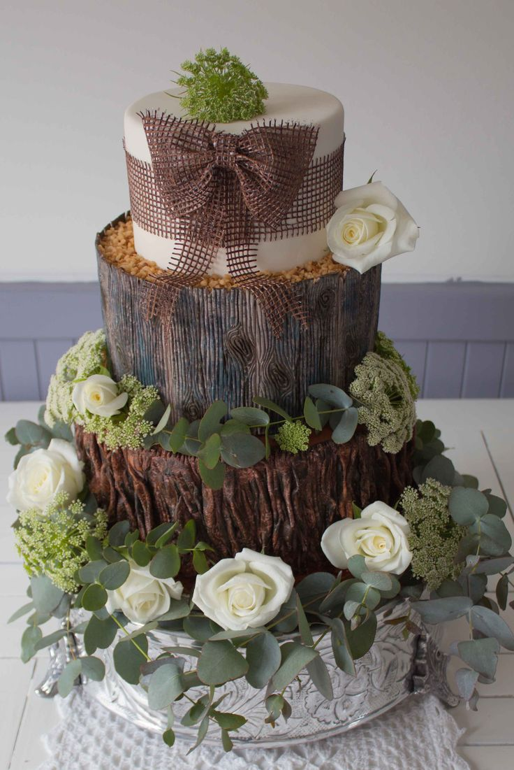 Woodland cake: a casual natural looking cake made slightly more formal with the inclusion of white roses.