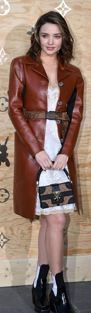 Who made  Miranda Kerr's red leather coat, white lace dress, boots, and black handbag?