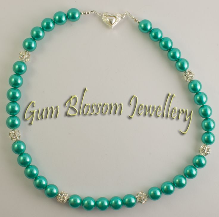 Green glass pearls with rhinestone highlights. This pretty magnetic heart clasp can be worn in front as a pendant or behind for a simpler look