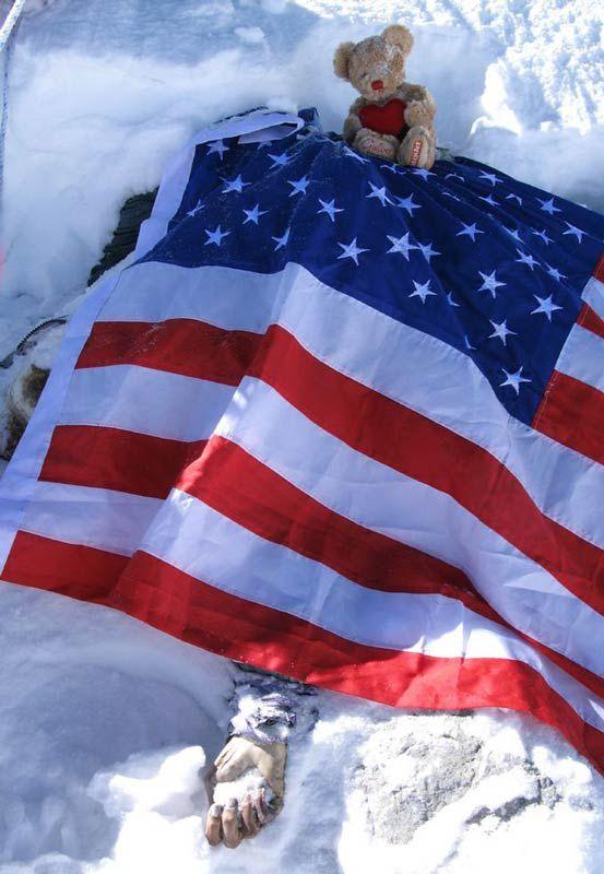 Francys Arsentiyev's body shrouded by an American flag