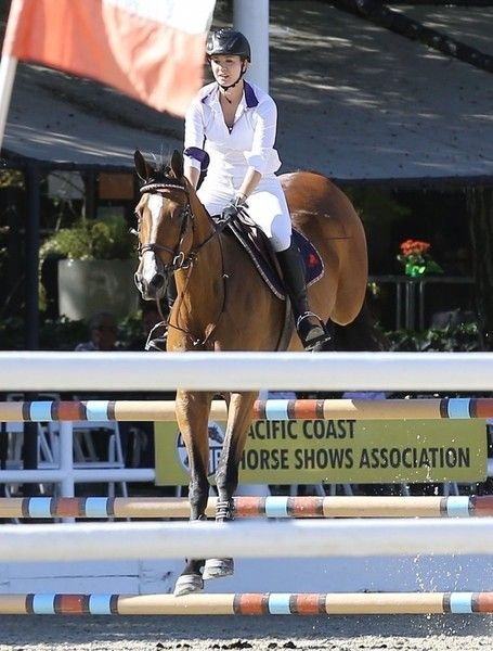 Kaley Cuoco Photos Photos - 'The Big Bang Theory' actress Kaley Cuoco participates in a horse jumping competition at the Flintridge Riding Club in Los Angeles, California on September 26, 2015. - Kaley Cuoco Participates in a Horse Jumping Competition