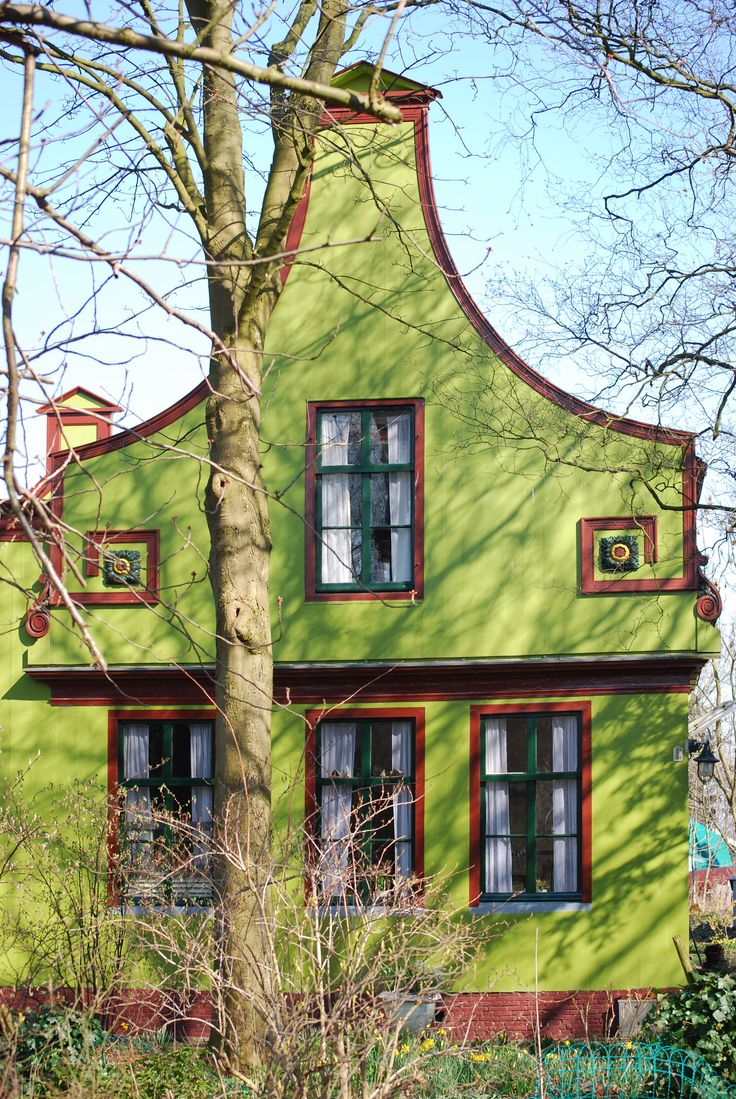 House in Zaanstreek, NL.  (The unique architecture & the color of the traditional buildings in North Holland are Favorite Things!)