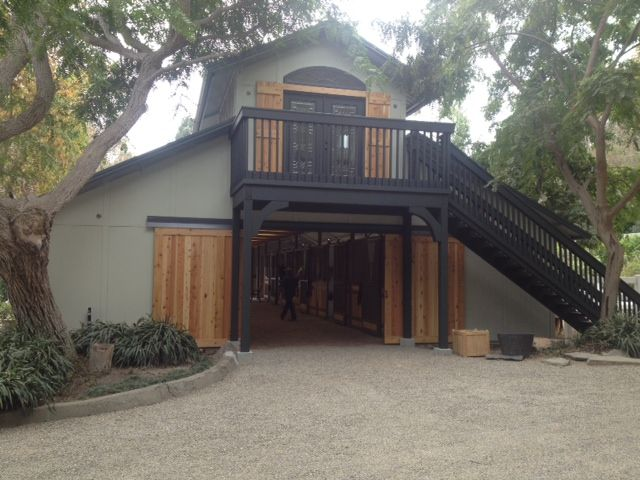 """Nice MDBarnmaster Raised Center Aisle Barn with a """"man cave Loft"""" It features Elite stall Fronts and enhanced with Cedar Tongue and Groove. Located in Southern California"""